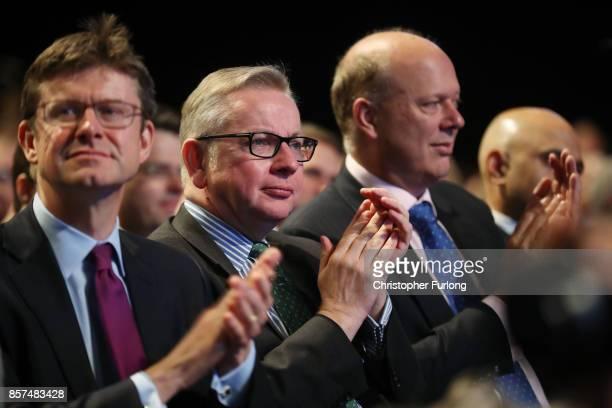Business secretary Greg Clark Environment secretary Michael Gove and Transport secretary Chris Grayling applaud before British Prime Minister Theresa...