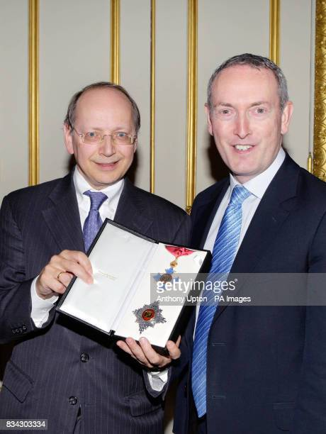 Business Secretary John Hutton presenting an honorary knighthood to Ben Verwaayen the Dutch born Chief Executive of BT Group for his services to the...