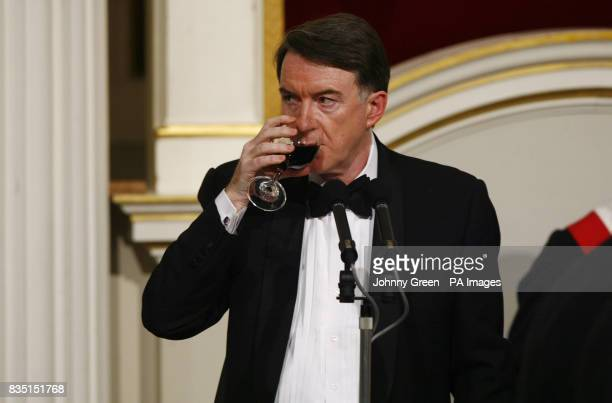 Business Secretary Lord Mandelson drinks a toast before his speech at the annual Trade and Industry Dinner at Mansion House in the City of London...