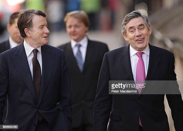 Business Secretary Lord Mandelson shares a joke with Prime Minister Gordon Brown as they walk to The Good Governance Conference on February 19 2010...