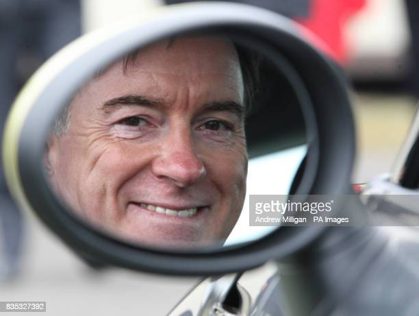 Business Secretary Peter Mandelson seen in the wing mirror of the Mini E electric vehicle at Knockhill race track after launching the Government's...