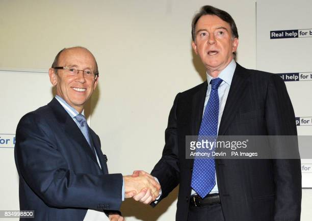 Business Secretary Peter Mandelson shakes hands with chairman of Standard Chartered Bank Mervyn Davies as he is made Minister of State in Lord...