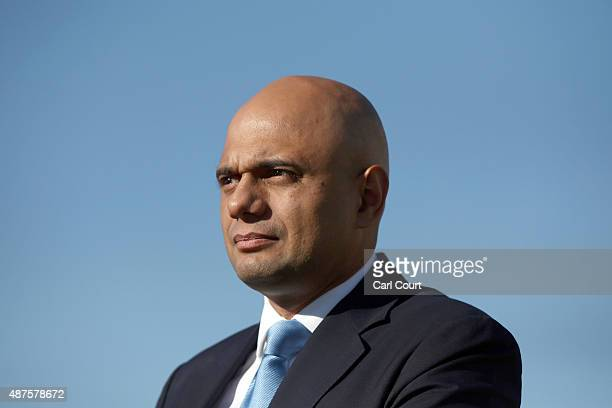 Business Secretary Sajid Javid attends a photocall with executives from British car manufacturers on September 10 2015 in London England Executives...