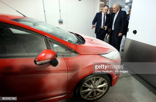 Business Secretary Vince Cable looks at a Ford Fiesta under test in a cold room at 16 C during a visit to Ford Technical Centre at Dunton Essex after...