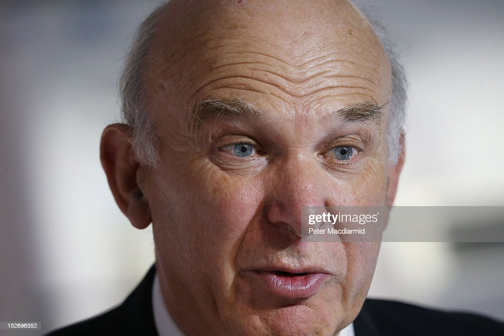 Business Secretary Vince Cable talks to reporters during a visit to the Ricardo Engine Assembly plant on September 24, 2012 in Shoreham-by-Sea, England. Later Mr Cable will announce a new bank to enable easier lending to businesses.