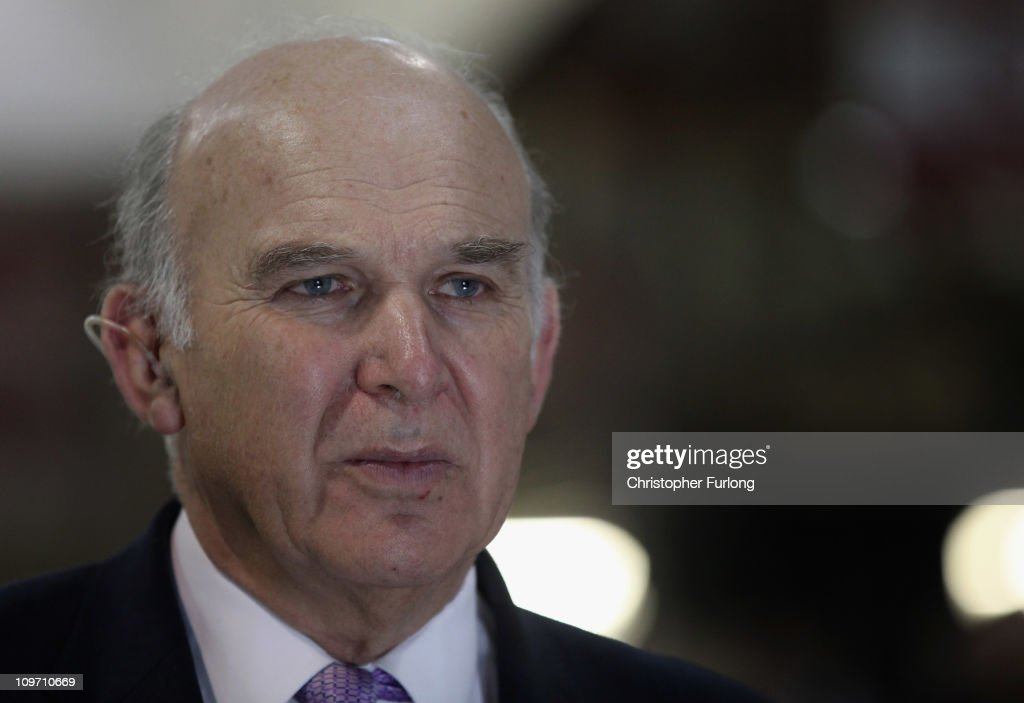 Business Secretary Vince Cable talks to the media as he tours the Jaguar Land Rover Halewood assembly plant on March 2, 2011 in Halewood, England. During his tour the company announced over £2 billion worth of supply contracts to more than 40 companies in the UK for its new Evoque model creating 1,500 new jobs. The Range Rover Evoque is due to go on sale this Summer.