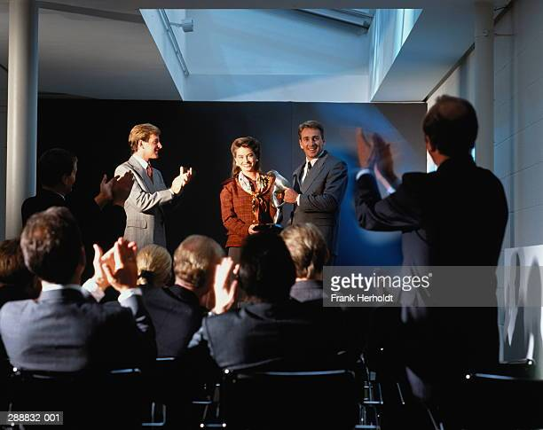 Business seminar,man being presented with award