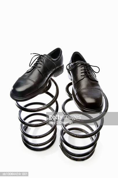 Business shoes on springs