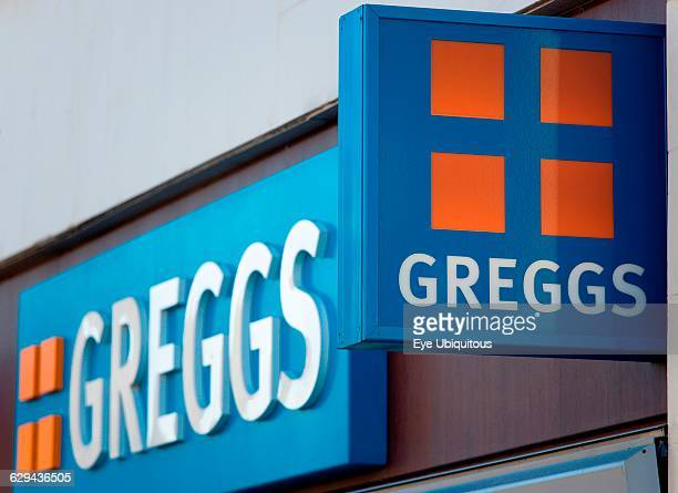 Business Shops Food Greggs pie shop signs on a high street outlet