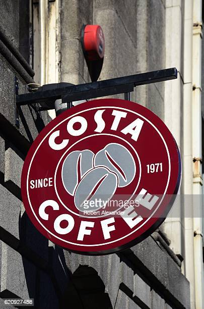 A business sign hangs over the entrance to a Costa Coffee shop in Dublin Ireland Headquartered in England the British multinational coffeehouse is a...