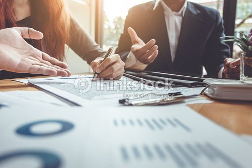 Business Signing a Contract Buy - sell house. : Stock Photo