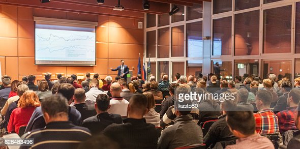Business speaker giving a talk in conference hall. : Foto stock