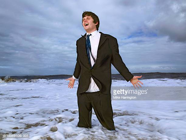 Business standing in sea and screaming