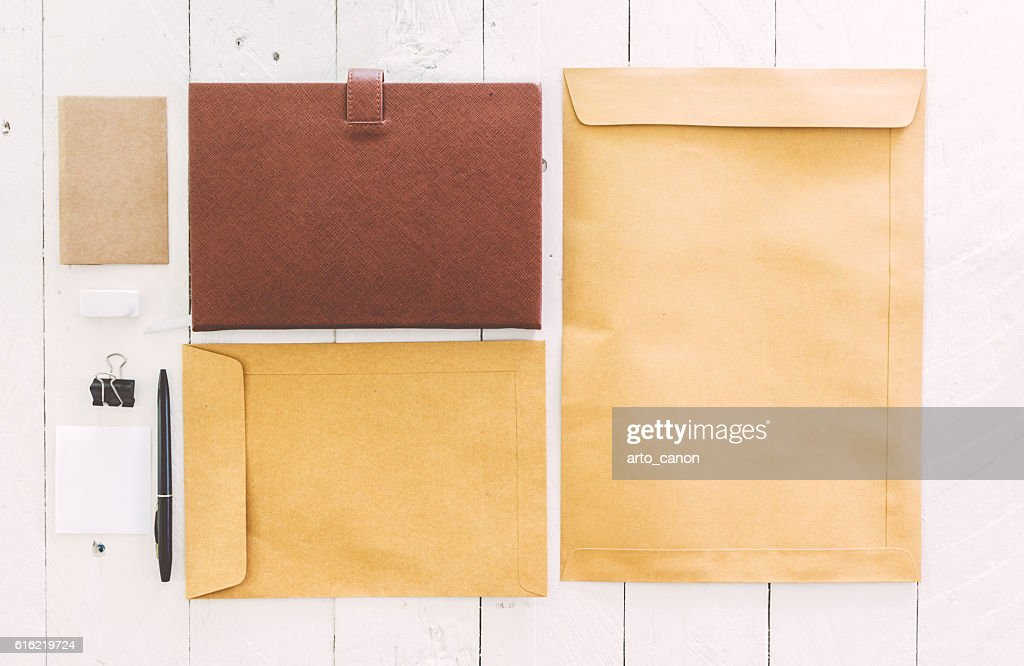 Business stationary set on wooden background : Foto stock