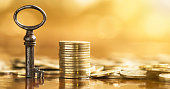 Business success banner - key and golden money coins