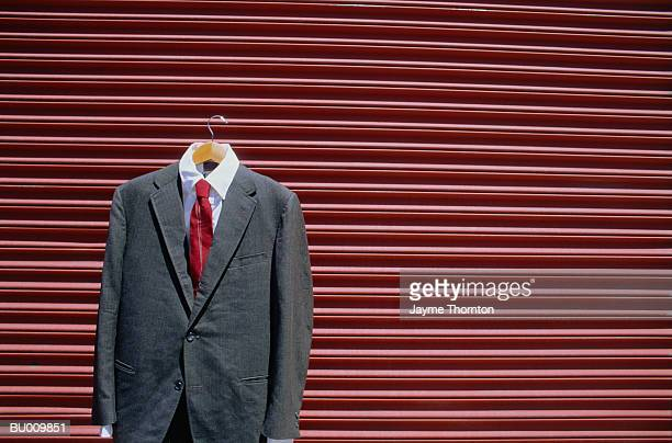 Business Suit and  Metal Wall