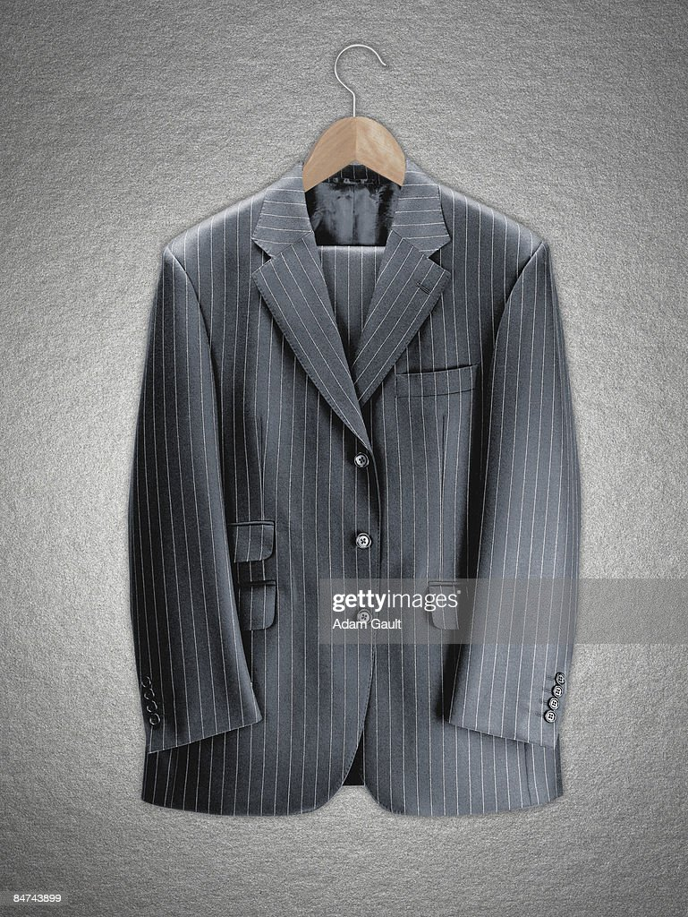 Business suit on coat hanger : Stock Photo