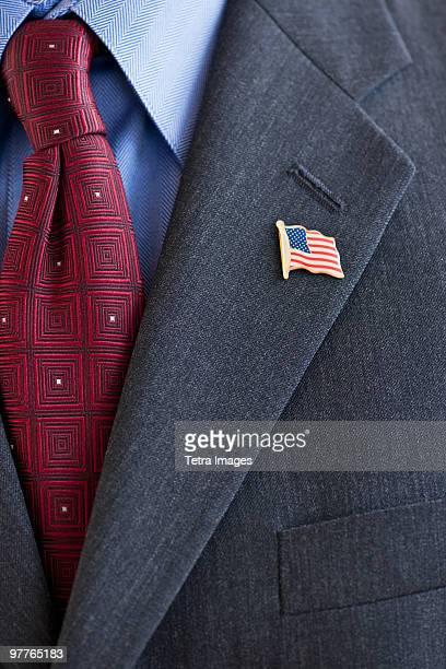 Business suit with pin of American flag on lapel