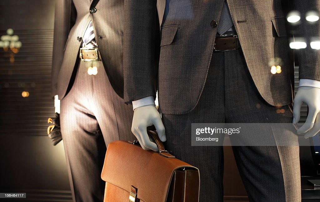 Business suits are displayed in a store window in Beijing, China, on Monday, Nov. 12, 2012. China's retail sales exceeded forecasts and inflation unexpectedly cooled to the slowest pace in 33 months, signaling the government is boosting growth without driving a rebound in prices. Photographer: Tomohiro Ohsumi/Bloomberg via Getty Images