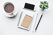 Business table top with mock up office supplies on white background.Flat lay design.Copy spaceBusiness table top with mock up office supplies on white background.Flat lay design.Copy spaceBusiness tab