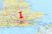 Map of The United Kingdom with red push pin shows London City as a business target concept.