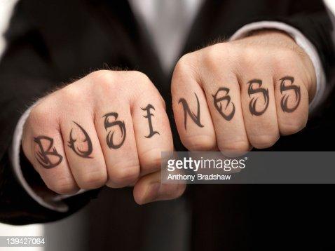 Business tattood on fists