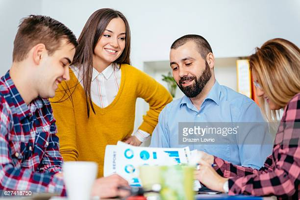 Business team analyzing business data in office
