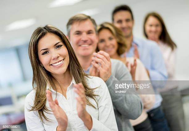 Business team applauding at the office