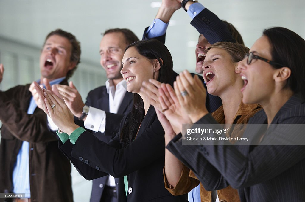 Business team applauding, smiling