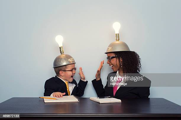 Business Team Celebrates wearing Mind Reading Helmets
