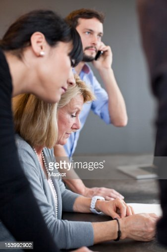 Business team discussing in office : Stock Photo