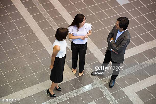 Business team meeting in business hall for informal chat