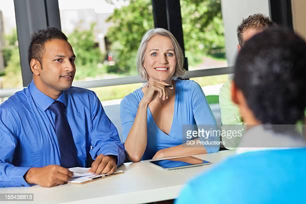 Business team of professionals conducting job interviews