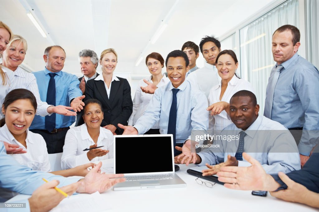 Business team presenting a laptop : Stock Photo