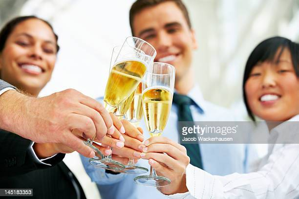 Business team toasting champagne flutes