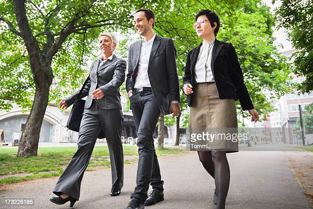 Business Team Walking in a Park