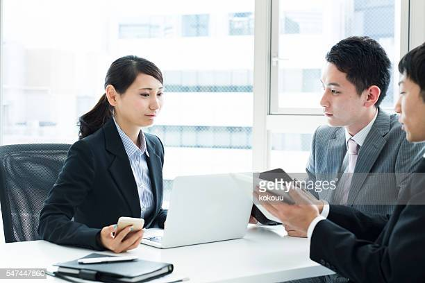 Business team with a conference while looking at the document