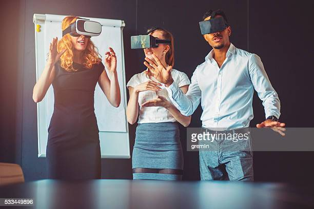 Business team with virtual reality goggle, meeting