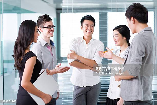 Business team workers in conversation