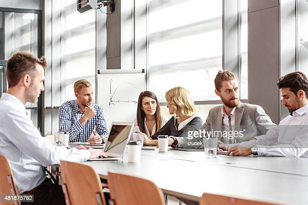 Business team working together in board room