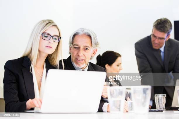 Business team working together in conference room