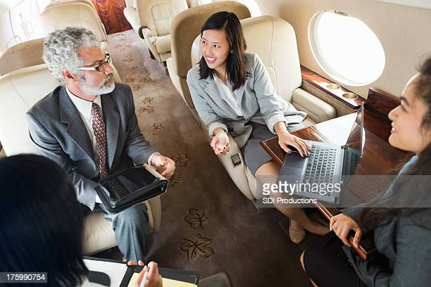 Business team working whlie travelling on corporate private jet