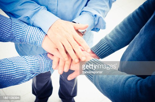 Business teamwork with a stack of hands