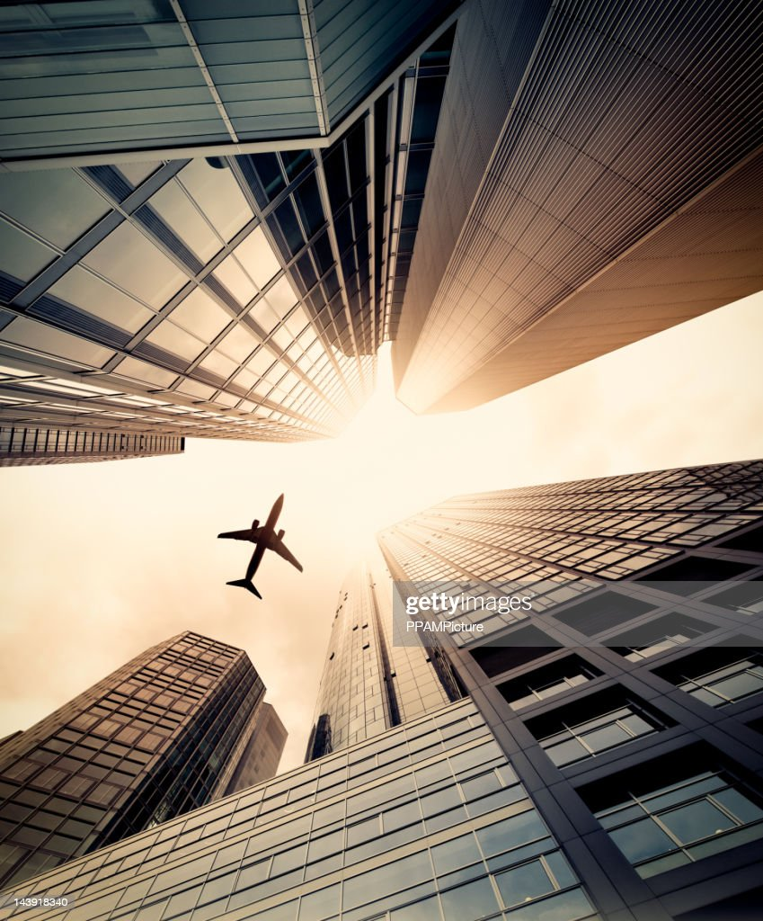 Business towers with a airplane silhouette : Stock Photo