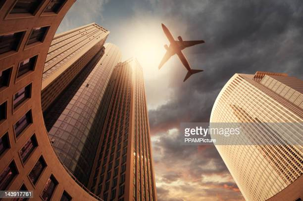 Business towers with an airplane silhouette
