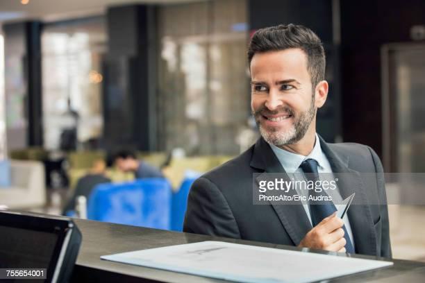 Business traveler at hotel reception