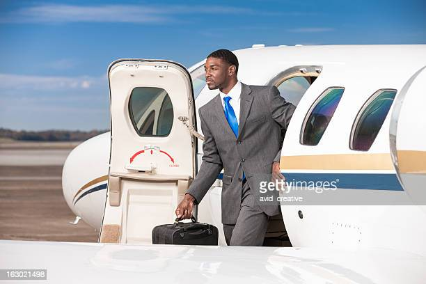 Business Traveler Exiting Private Corporate Jet