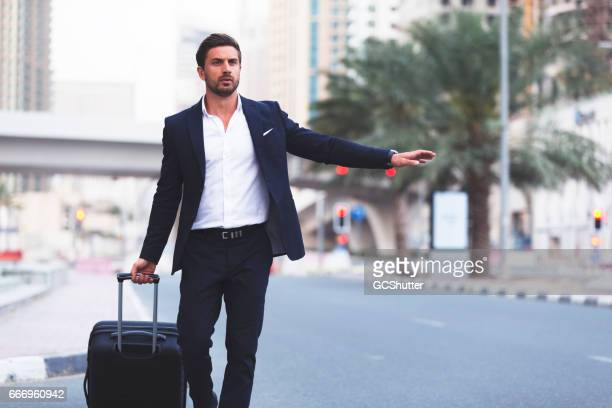 Business Traveller hailing a cab