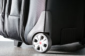 Business trip concept.  Suitcase on the floor. Travel background.