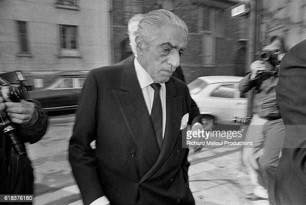 Business tycoon Aristotle Onassis is surrounded by reporters as he arrives at a Paris hospital shortly before his death
